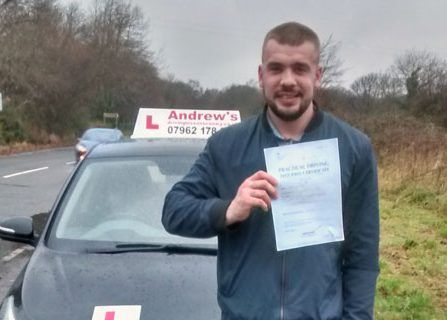 Chasey in Colwyn Bay after passing his driving test with Naz from Andrew's Driving School