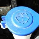 Screenwash bottle in engine compartment of Ford Fiesta