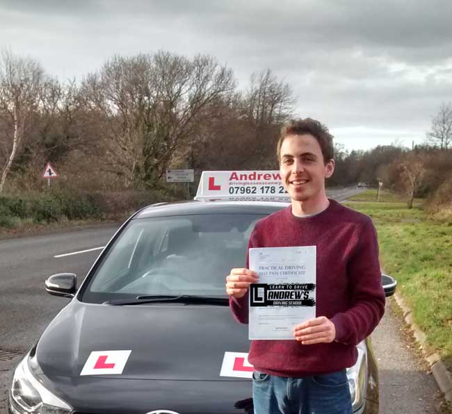 Glen From Old Colwyn stood by Naz's Driving School Car after taking his driving test in Bangor