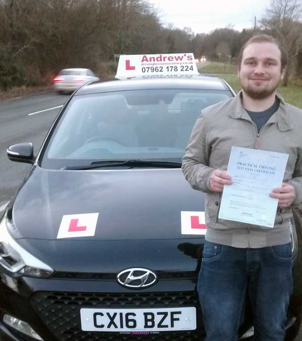 Sean from Llandudno looking happy after passing his driving test in North Wales, after a course of lessons with Naz.