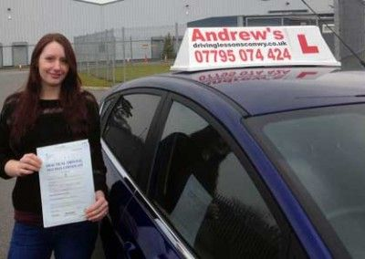 Kim from Penmaenmawr after passing her driving test first in Bangor on 16th March 2015