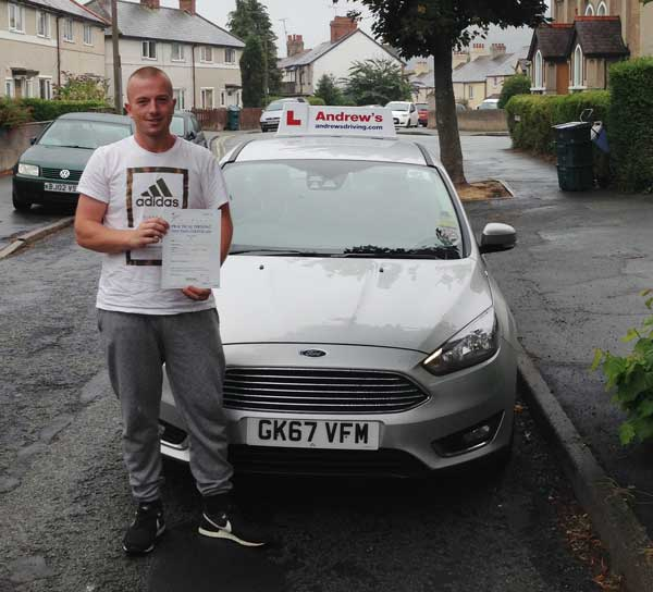 Jason in Llandudno Junction looking happy after passing his driving test in North Wales