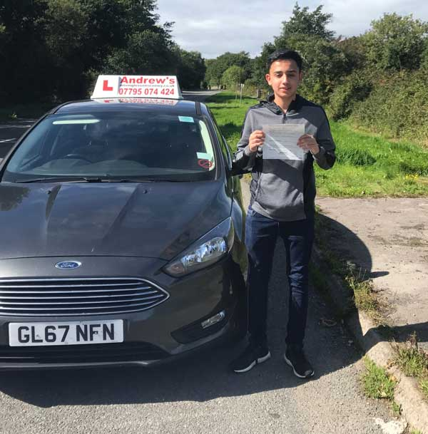 Kaleem in Rhos on Sea after passing his driving test in Bangor .