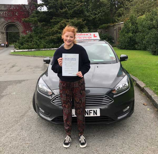 Olivia outside Penrhyn castle passing Driving test in a Ford Focus