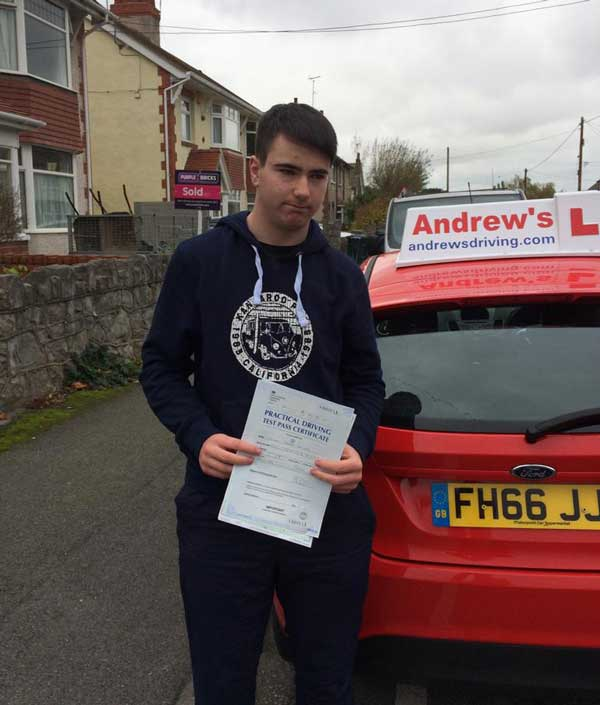 Dylan standing outside Rhyl Driving Test Centre.