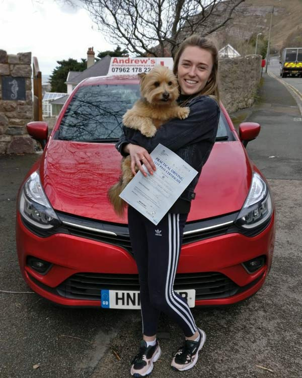 Abbie in Llandudno with her dog after passing her driving test