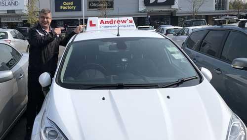 Driving instructor and car in Ellesmere Port