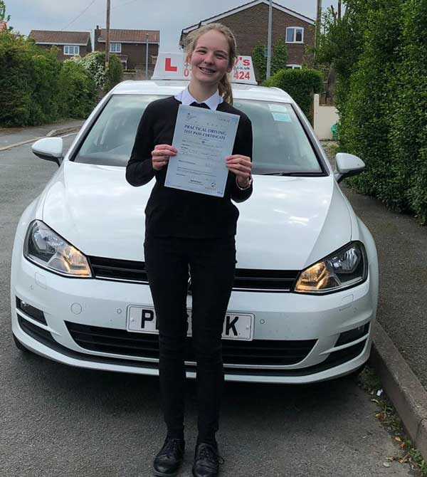 Laura passed her driving test.