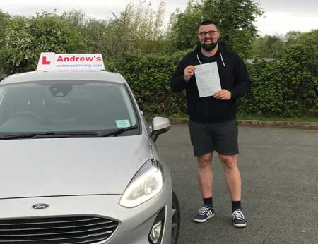 Michael with his DVSA driving test pass certificate