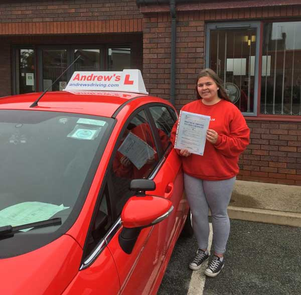 Bethan  with her driving instructors car in Rhyl