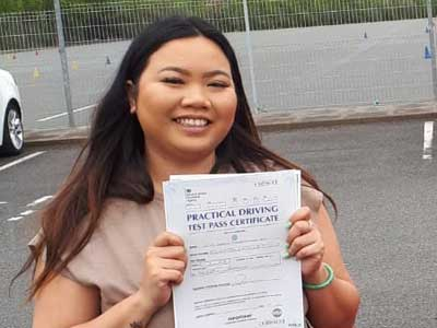 Kathie with her automatic driving test certificate