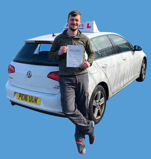 Adam standing by driving school car  with driving test certificate