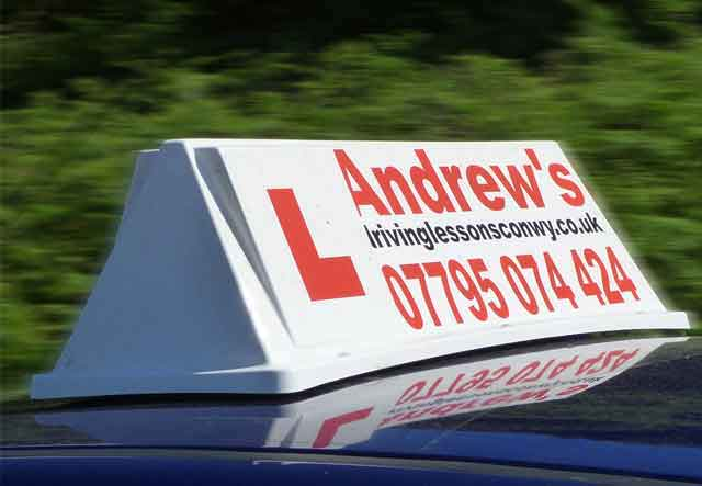 Andrew's Driving School car roof sign
