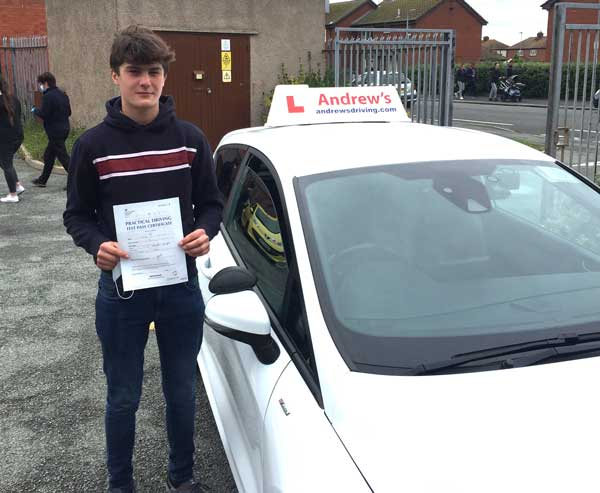 Outside RHyl driving test centre with a pass certificate