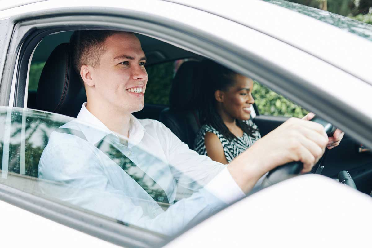 A young man happy on his driving lesson